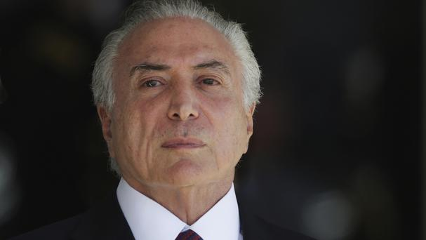 Michel Temer has denied any wrongdoing and insists he will not resign (AP)