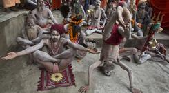 Indian Sadhus, or Hindu holy men, mark International Yoga Day at Kamakhya temple in Gauhati, India (Anupam Nath/AP)