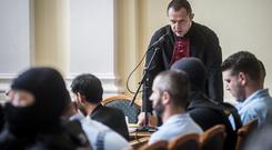 Defendants listen to the speech of prosecutor Gabor Schmidt (Sandor Ujvari/MTI via AP)