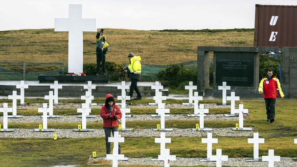 Personnel work in the Argentine memorial cemetery in Darwin, on the Falkland Islands (Didier Revol/ICRC via AP)