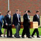 The casket of Otto Warmbier is carried to the hearse, followed by his family and friends, after the funeral service. Photo: Reuters