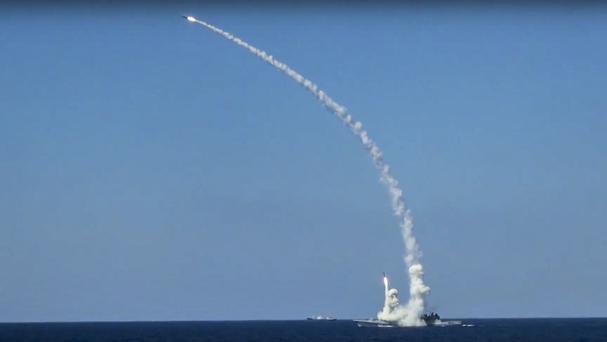 Long-range Kalibr cruise missiles are launched by a Russian navy ship in the eastern Mediterranean (Russian Defence Ministry Press Service via AP)