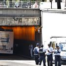 French police officers block the area after a bus hit the roof of a Paris tunnel (Thibault Camus/AP)