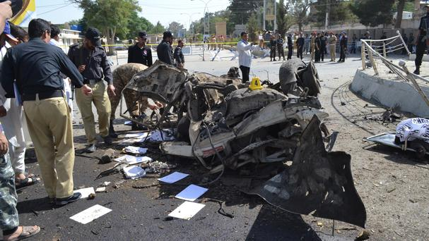 Police officers examine the site of an explosion in Quetta (Arshad Butt/AP)
