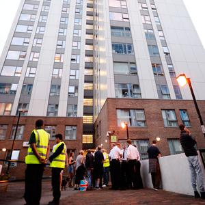 Residents leave the Taplow tower block on the Chalcots Estate in Camden, London, last night. Photo: Stefan Rousseau/PA Wire.