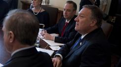 Mike Pompeo, right, at a cabinet meeting with President Donald Trump