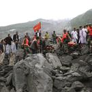 Emergency personnel at the site of a landslide in Xinmo village (Xinhua)