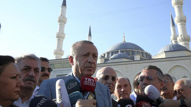 President Recep Tayyip Erdogan speaks to the media after Eid prayers in Istanbul