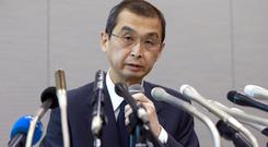 Takata CEO Shigehisa Takada speaks during a press conference in Tokyo