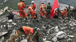 Rescuers at the site of a landslide in Xinmo village in China's Sichuan province (AP)