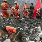 Rescuers at the site of a landslide in Xinmo village in China's Sichuan province (AP Photo/Ng Han Guan, File)