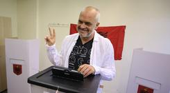 Albanian Prime Minister and Socialist party leader Edi Rama casts his ballot at a polling station in Tirana (AP)