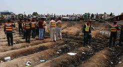 Pakistani rescue workers at the site of an oil tanker explosion on a highway near Bahawalpu (AP)