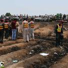 Pakistani rescue workers at the site of an oil tanker explosion on a highway near Bahawalpu (AP Photo/Iram Asim)