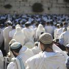 The Israeli government has dropped a plan to open a mixed-gender prayer area at Jerusalem's Western Wall (AP)