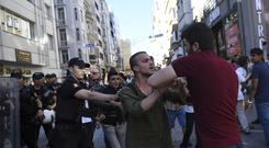 Riot police move to detain a man as they stop LGBTI protesters from gathering in large numbers in Istanbul (AP)
