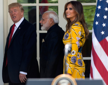 US President Donald Trump walks with Indian Prime Minister Narendra Modi and First Lady Melania Trump past the Rose Garden at The White House in Washington DC yesterday. Photo: Getty Images