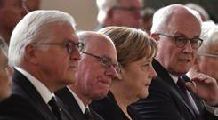 German Chancellor Angela Merkel attends the service (John Macdougall/Pool Photo via AP)
