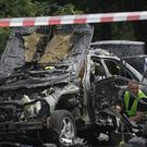Forensic experts examine the wreckage of a car in Kiev, Ukraine (AP)