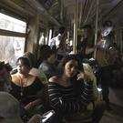 Subway passengers on an A train with the lights out after it halted just shy of the 125th street stop in New York's Harlem neighbourhood (Jackie Faherty via AP)