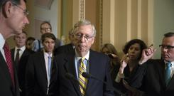 Mitch McConnell tells reporters he is delaying a vote on the Republican healthcare bill (J Scott Applewhite/AP)