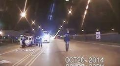 Laquan McDonald, right, moments before being fatally shot by police officer Jason Van Dyke (Chicago Police Department via AP)