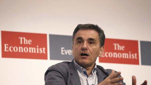 Greek Finance Minister Euclid Tsakalotos speaks during an economic conference in Lagonisi near Athens (AP)