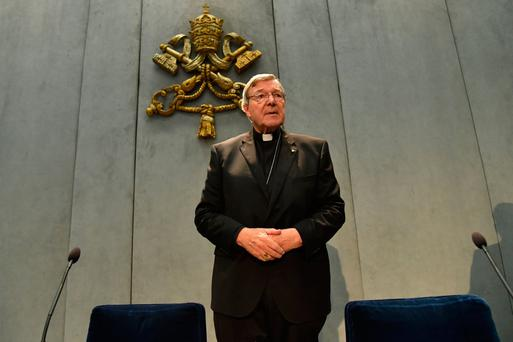 Australian Cardinal George Pell makes a statement at the Holy See press office in the Vatican city yesterday. Photo: Getty