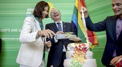 Katrin Goering-Eckardt and Volker Beck, of the Green Party, symbolically cut a wedding cake at the German Bundestag in Berlin (dpa/AP)
