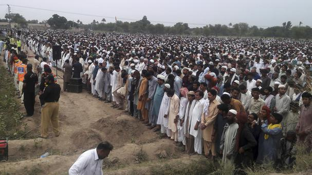 People offer funeral prayers for the victims of Sunday's fuel tanker fire incident in Bahawalpur, Pakistan (AP Photo/Iram Asim)