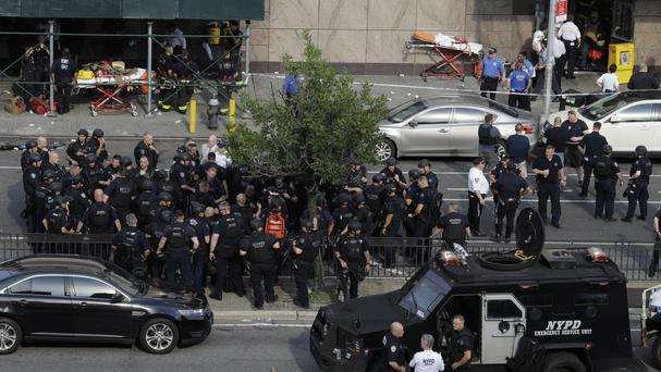 Police gathered outside Bronx Lebanon Hospital after reports of a shooting (AP)