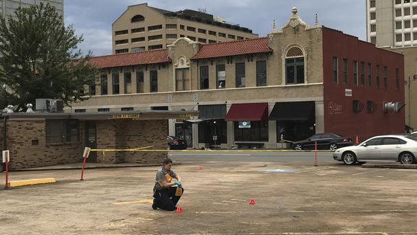 An investigator collects evidence near the Arkansas nightclub where police say multiple people were shot (AP Photo/Andrew DeMillo)