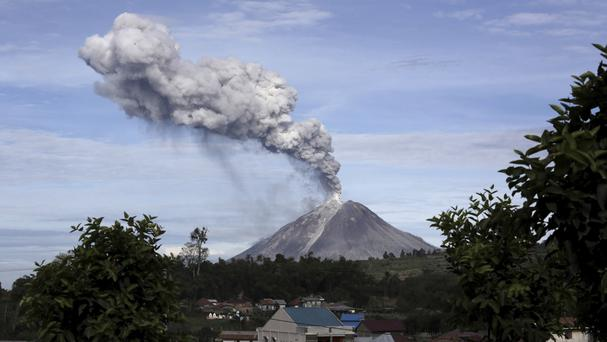 On North Sumatra, Mount Sinabung has in recent days been spewing volcanic ash into the air (Binsar Bakkara/AP)