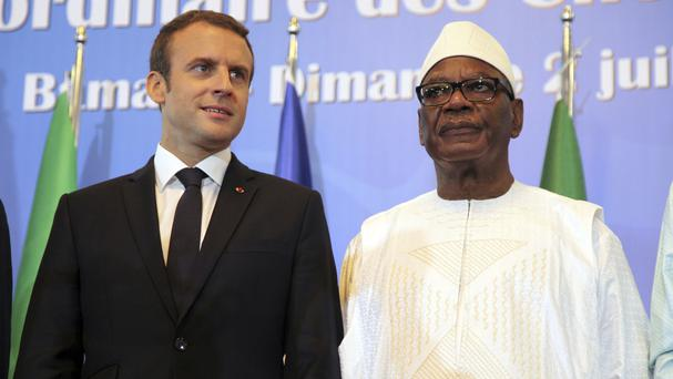 French President Emmanuel Macron, left, stands next to Malian counterpart Ibrahim Boubacar Keita during the opening session of G5 Sahel force summit in Bamako, Mali (Baba Ahmed/AP)