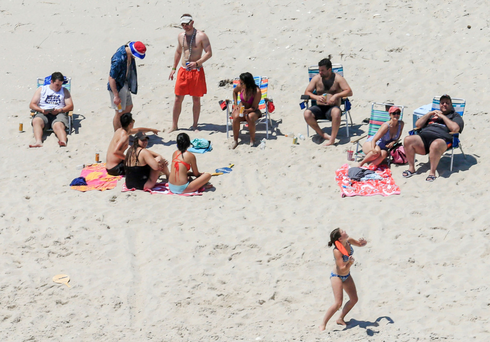 New Jersey Gov. Chris Christie uses the beach with his family and friends at the governor's summer house at Island Beach State Park in New Jersey. Photo: AP