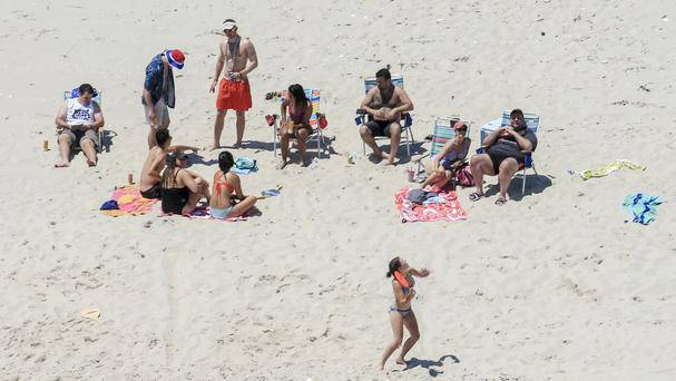 Governor Chris Christie, right, with his family and friends on a beach that he had closed to the public (Andrew Mills/NJ Advance Media via AP)