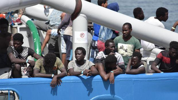 Migrants arrive in Italy as Austria says it is ready to