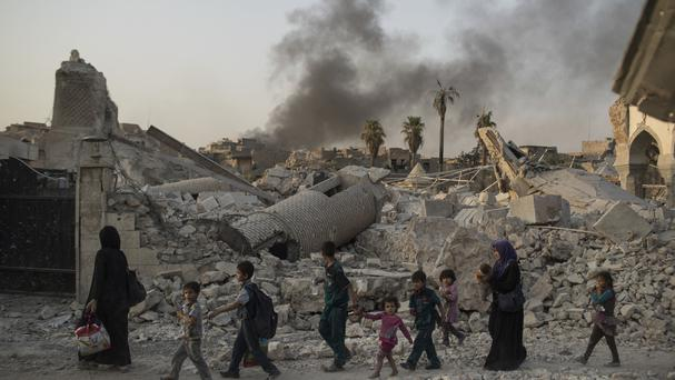 Civilians flee the Old City of Mosul as Iraqi forces continue to advance on the last area held by IS (AP)