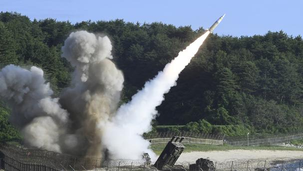 A missile is fired during a combined military exercise between the US and South Korea (South Korea Defence Ministry/AP)