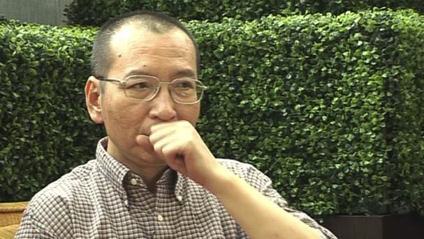 Liu Xiaobo speaking during a 2008 interview before his detention in Beijing (AP)