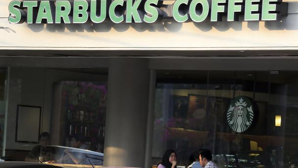 An Indonesian couple sit at Starbucks shop in Jakarta (AP)