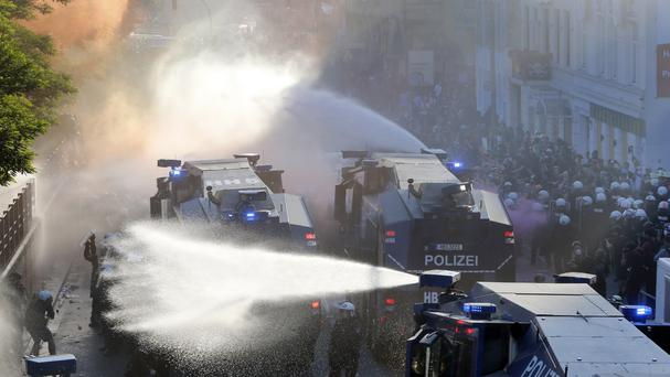 Police use water canons during a protest against the G20 summit in Hamburg (AP)