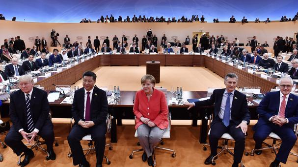 World leaders including Angela Merkel at the start of the first working session of the G20 summit in Hamburg (AP)