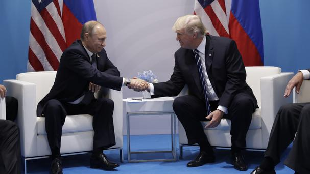 Vladimir Putin and Donald Trump sit down together at the G20 summit (AP)