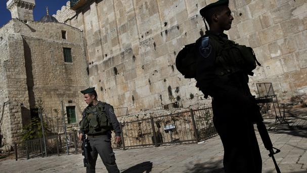Israeli border police stand guard in the West Bank city of Hebron (AP)