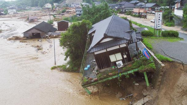 Collapsed houses after the flooding caused by heavy rain in Asakura, Fukuoka prefecture (Kyodo News/AP)