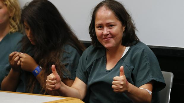 Isabel Martinez gestures towards news cameras during her first court appearance (AP)