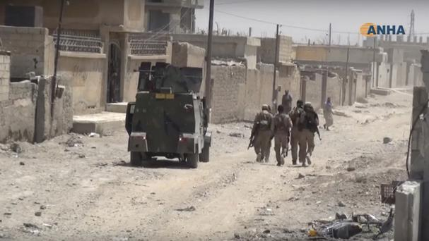 US-backed Syrian Democratic Forces fighters in the eastern side of Raqqa, Syria (Hawar News Agency/AP)