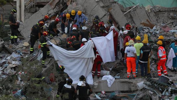 Italian apartment block collapses, burying up to 7 people