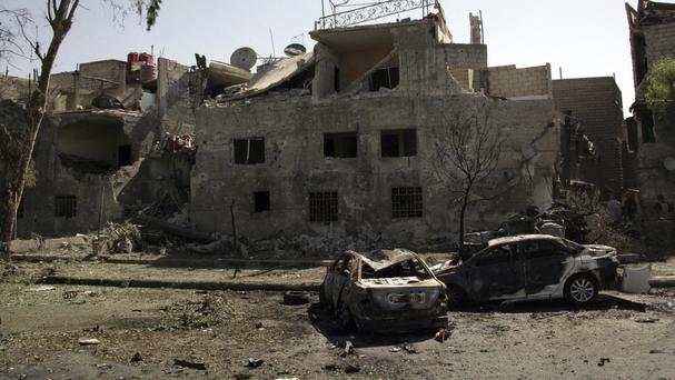 Damaged cars along the road to the airport in south-east Damascus, Syria (SANA via AP)